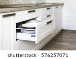 opened kitchen drawer with... | Shutterstock . vector #576257071