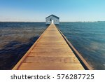 a boat shed at the end of a... | Shutterstock . vector #576287725
