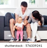 happy couple with baby child. | Shutterstock . vector #576339241