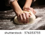 Male Hands Kneading Dough On...