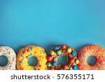 glazed donuts on color... | Shutterstock . vector #576355171