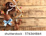 Stock photo chocolate easter eggs with color ribbon bows on wooden background 576364864