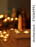 Small photo of Beautiful composition of alight candles in spa salon