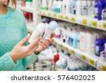 woman in shop chooses deodorant ... | Shutterstock . vector #576402025