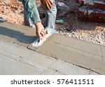 close up  hands of workers were ... | Shutterstock . vector #576411511