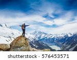 hiker with backpack on the... | Shutterstock . vector #576453571