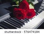red roses on piano keys | Shutterstock . vector #576474184