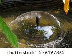 pond fountain splashing water... | Shutterstock . vector #576497365