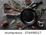 Stock photo dark culinary background with empty black pan and space for text recipe or menu 576498517