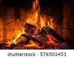 a fire burns in a fireplace. | Shutterstock . vector #576501451