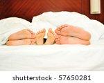 Happy family in bed, six feet - stock photo