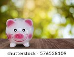piggy bank with shinny bokeh in ... | Shutterstock . vector #576528109
