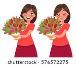 Woman Holding A Bouquet Of...