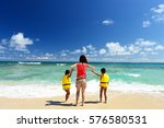 family playing on the beach in... | Shutterstock . vector #576580531