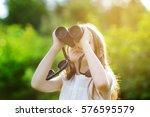 funny little girl looking... | Shutterstock . vector #576595579