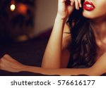 sexy woman with red lips on bed ...   Shutterstock . vector #576616177