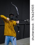 Small photo of Woman with crossbow arrows bow. The Archer takes aim, sharpshooter. Crossbow club.