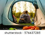 shot of a happy couple camping... | Shutterstock . vector #576637285