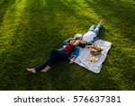 happy young couple in the park... | Shutterstock . vector #576637381