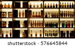 Stock photo various alcohol bottles in a bar back light all logos removed 576645844