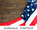 the american flag on wooden... | Shutterstock . vector #576670135
