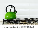 stainless tea kettle in green... | Shutterstock . vector #576713461
