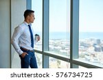 confident young businessman... | Shutterstock . vector #576734725