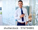 portrait of a smiling young... | Shutterstock . vector #576734881