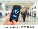 free wi fi concept.hands... | Shutterstock . vector #576740749