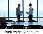 two businessmen deep in... | Shutterstock . vector #576773074