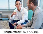 two smiling male work coworkers ... | Shutterstock . vector #576773101