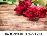 Stock photo red rose petals in water drops rose petals 576775045