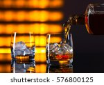 glass of whiskey with ice on a...   Shutterstock . vector #576800125