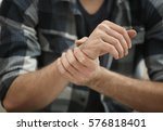 man suffering from pain in... | Shutterstock . vector #576818401