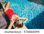enjoying suntan and vacation.... | Shutterstock . vector #576860095