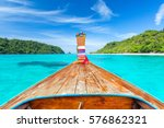Stock photo long tail boat against blue sky and sea koh rok island krabi thailand 576862321