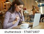 beautiful brunette using laptop ... | Shutterstock . vector #576871807
