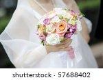 Bride Holding Beautiful Pink...