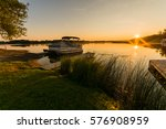 view of lake sunrise showing... | Shutterstock . vector #576908959