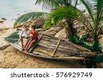 couple in love on the seaside... | Shutterstock . vector #576929749