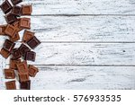 milk and black chocolate pieces ... | Shutterstock . vector #576933535