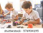 concentrated children in light... | Shutterstock . vector #576934195