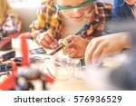 curious boys working with... | Shutterstock . vector #576936529