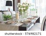elegant table set in vintage... | Shutterstock . vector #576982171