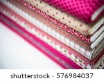 stack of fabric red pink cloth... | Shutterstock . vector #576984037