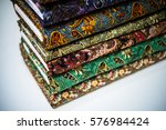 stack of fabric paisley cloth... | Shutterstock . vector #576984424