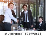 business team are showing unity ... | Shutterstock . vector #576990685
