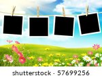 Stock photo spring flowers with photos on clothes line 57699256