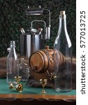 Small photo of Manufacture of wine, vodka. still life with a picture of glass bottles, a keg on a background of the slain bear skins.