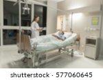 blurred doctors taking care of... | Shutterstock . vector #577060645
